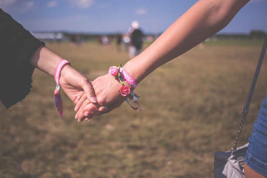 Holding hands on a sunny day
